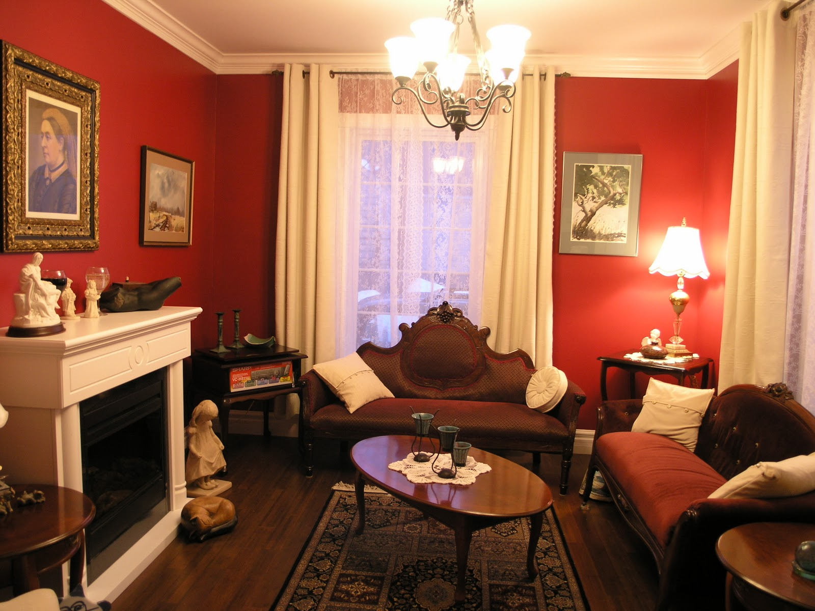 Victorian Living Room With Red Wall White Curtains Brown Sofa Wooden Table  Stylish Rug And White