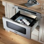 Viking-24inch-DrawerMicro-Oven-VMOD241SS-with-sleek-style-and-slim-design-with-child-lock-safety-feature-and-installed-in-beige-cabinet-also-wooden-floor