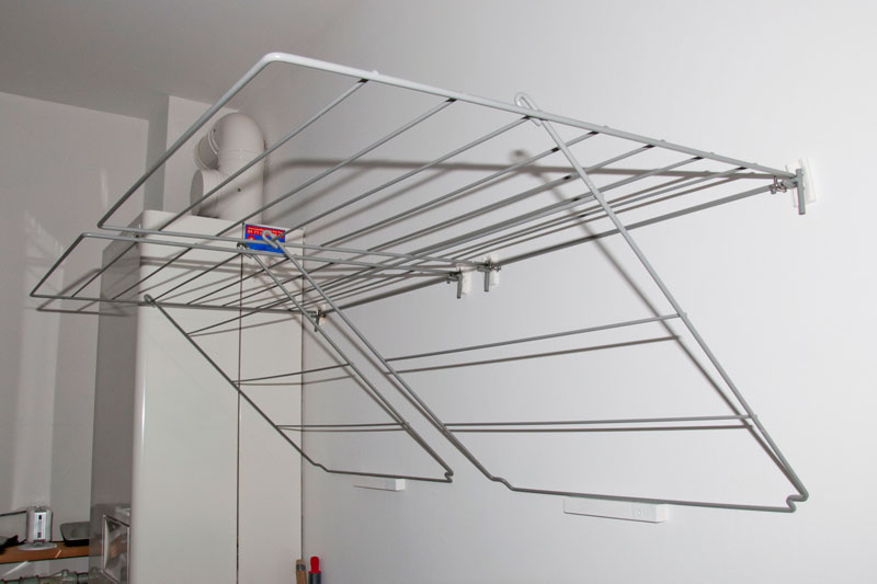 wall mount metal wire clothes drying rack designed by ikea