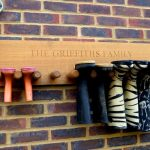 Wall mounted wooden rack idea for hanging boot collections