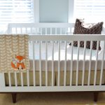 White Baby Crib And Mattres Shaders And Yellow Curtains On Windows Warm Carpet