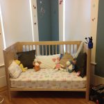 White Bed With Pillows And Dolls Kid Room