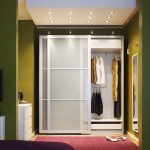 White Bedroom Sliding Closet Door Inside The Bedroom With Modern TV And Modern Cabinet