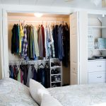 White Closet Bedroom With Doors Near White Bed And Pillows