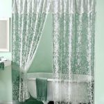 White-Elegant-Rose-in-Lace -Shower-Curtain-with-victorian-style-with-green-color-and-green-bath-towel-on-the=white-bathtub-near-soft-green-wall