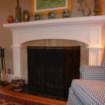 White Kits Of Fireplace In Living Room Near A Recliner And Decorative Carpet