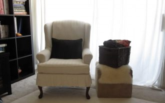 White Slipcovered Chair Curtain Carpet With Fur Table And Basket