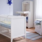 White baby crib IKEA for a nurturing room a white corner chair for nurturing small area rug in strip pattern