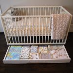 White baby crib idea with under storage for storing baby clothes