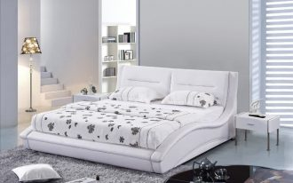 White leather headboard combined with white bed furniture white bedding and white pillows white modern bedside tables light grey shaggy rug for bedroom