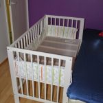 White painted wooden crib for baby
