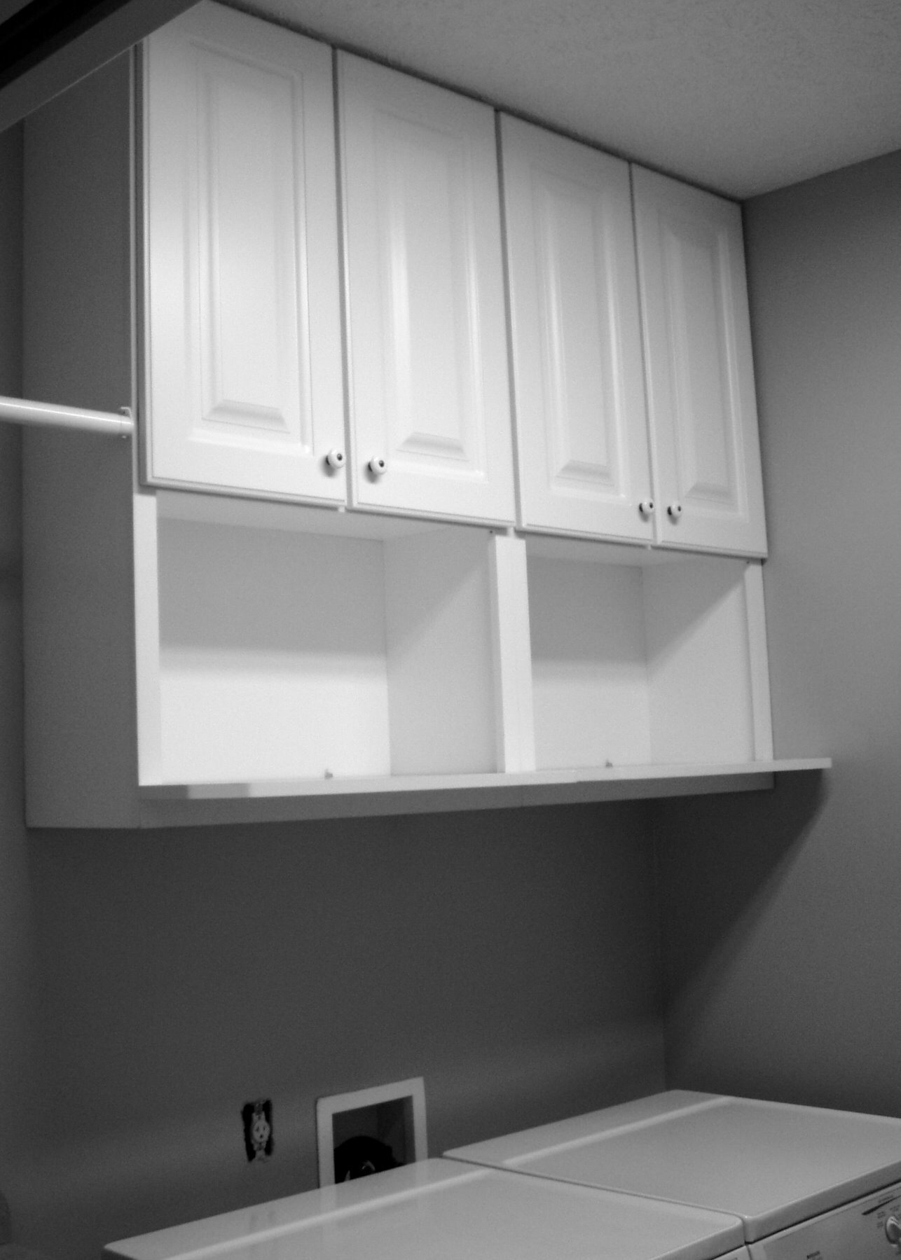 White Painted Wooden Wall Cabinets With Shelves Designed By IKEA