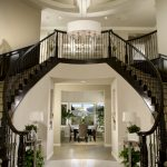 Wonderful Designing Of Home Stairs With White Wall Design And Round Chandelier