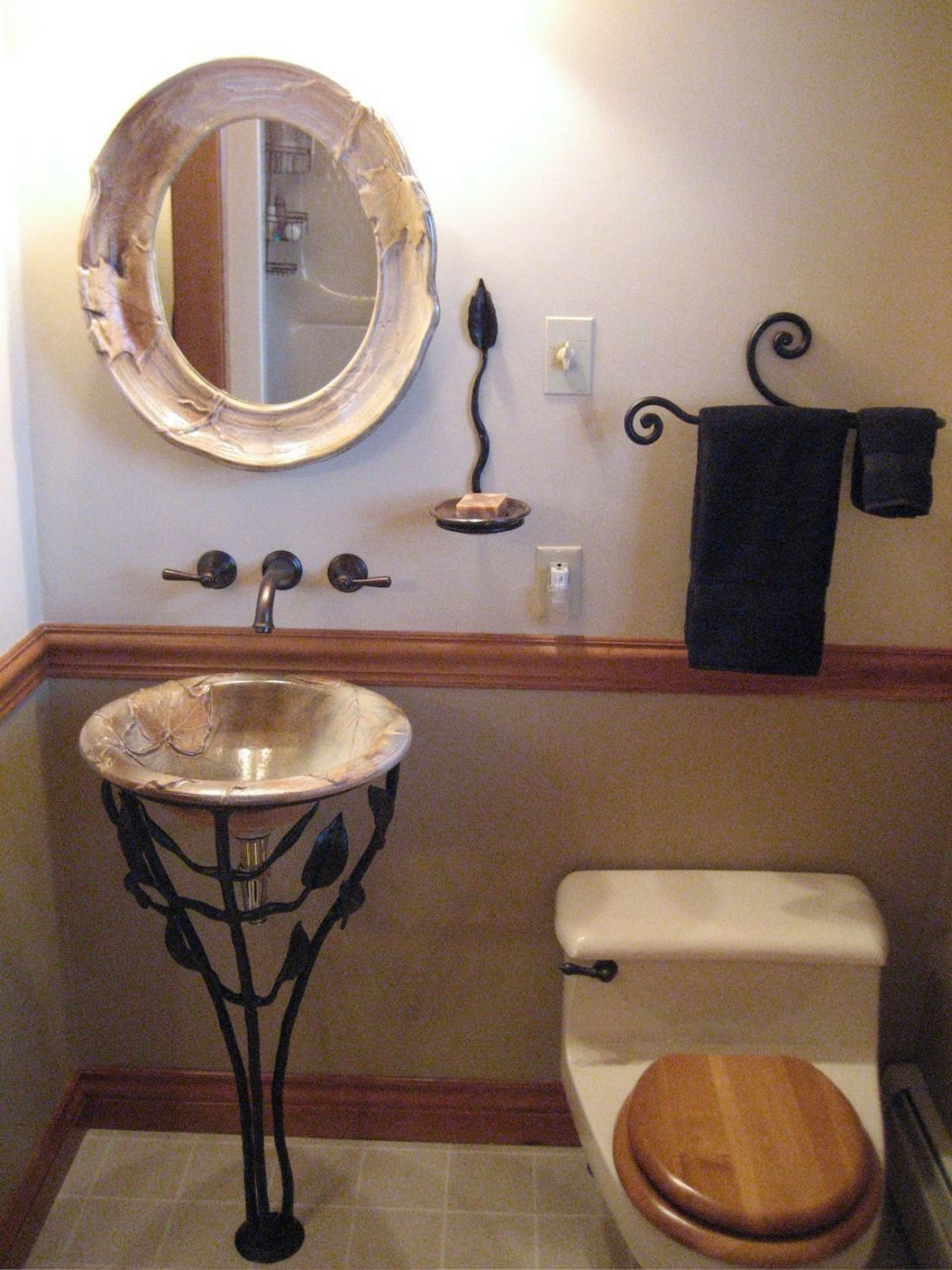 Wonderful vessel sink with black stained metal holder a round mirror with  beautiful frame a toilet. Small Vessel Sinks for Bathrooms   HomesFeed