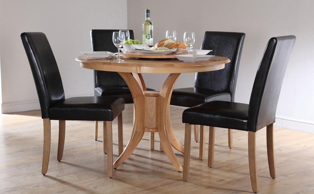 wooden round dining table with four black leather dining chairs - Round Dining Room Chairs