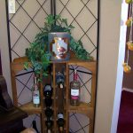 Wrought iron corner shelves for bottles of wine