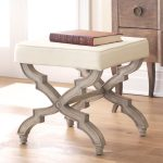 X base stool with white upholstery and weight metal