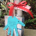a set of parcel for daycare teacher gift design with hand shape for card and red ribbon