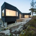 adorable black modern home on hill design with glass window and hovering style and rocky ground
