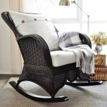 adorable black syntetic rattan rocking chair ikea deign with white pillow and upholster and gray rug and floor lamp and wooden table