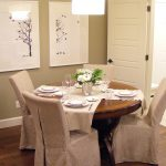 adorable dining room ideas with slip cover for chair and round wooden dining room plus attractive ceiling lamp and dark wooden floor