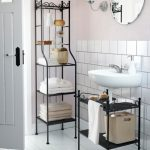 adorable freestanding black metal towel shelf idea with tile wall accent and wall mirror and wall lamp and white flooring