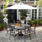 adorable graden furniture design with metal chairs and white umbrella patio on paved outdoor space