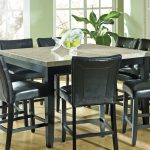 adorable granite dining table set in square shape with 8 black leather chairs and cute glass centerpiece for affectionate dining room