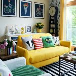 adorable interior design with wallpaper of water drop with wall palette and yellow sofa and stripe area rug and coffee table and soft blue sofa
