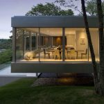 adorable lake house design with open plan and gray paint and glass facade idea overlooking lake