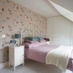 adorable loft bedroom idea with skylight and awesome peach floral cool wallpaper for wall with white dresser and green table lamp and pink bedding