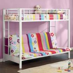 adorable low profile bunk bed with sofa and colorful floral sheet pattern and white area rug on wooden floor