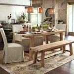 adorable mediterranian rustic kitchen studio design with wooden dining table and bench and white slipcover chair and pendants and open plan and wooden floor