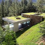 adorable modern white home on hillside idea with rooftop and lush vegetation and grassy meadow