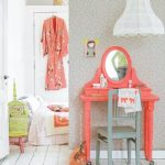 adorable white interior design with coral color small vanity and gray chair for kids with white pendant on wooden white floor