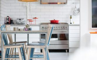 adorable white kitchen with corner booth dining set with blue white metal chairs and metal table and pendant