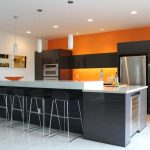 adorable white orange color kitchen paint idea with wall palette and large island and black stools and giant storage