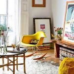 adorable yellow ikea rocking chair design in living room with pictures and large glass window and wooden coffee table and area rug and yellow pouff
