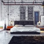 adorble small modern prefab home design with rustic bedroom with brick wall and black white siding and tripod floor lamp and black furry rug and open plan
