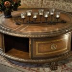 Amazing And Unique Round Coffee Tables With Storage With Craved Accent On Its Edge Completed With Shelves And Beautified With Chandeliers