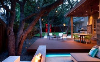amazing bright backyard patio design with wooden deck and pool idea with fire pit and pool chairs beneath shady tree