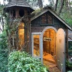 amazing-cottage-chicken-coop-in-the-backyard-with-door-and-window-and-woods-and-crepped-plants