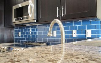 astonishing colored subway tile for kitchen backsplash decorated with wooden kitchen cabinets and modern space saving microwave plus marble countertop