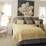 awesome yellow and gray bedroom decor idea with bold bedding and large jasmine picture on the wall with white sofa