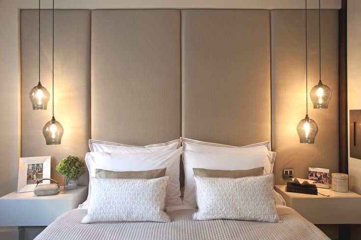 Beautiful Hanging Bedside Lamps And White Pillows