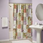 beautiful plaid pattern bohemian shower curtain ida with rod and tub and white freestanding sink and oval wall mirror and puple painted wall