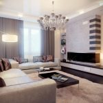beige-sofas-with-brown-cushions-and-white-fur-rug-and-chandelier-and-wooden-floor-and-white-wall-and-dark-brown-coffe-table-with-books-and-white-cup-over-it