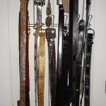 belt storage ideas behind the door with metal hooks