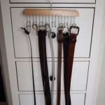 belt storage ideas with hanger made of wood and metal hung up on drawers