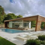 best architectural single level house plan with wooden siding with pools and large patio and open plan